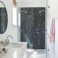 black marble herringbone shower tiles