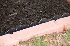 black mulch with black plastic garden edging