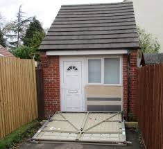Couple used FAKE garage door to hide secret home they built after ...