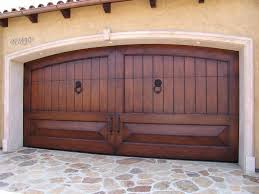 exterior door swing out or in. exterior design home swing out garage door with bronze handle trims ideas feat stone pavers or in
