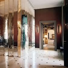 view in gallery elegant entryway with a pleated mirror wall
