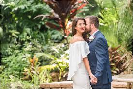 bride and groom laughing at florida tech botanical gardens wedding