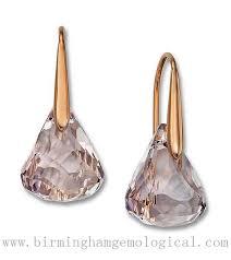 swarovski 24k rose gold plated lunar crystal blush pierced earrings cool dawn blue cool