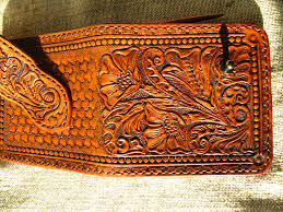 a hand made tooled carved wallet billfold old
