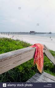 hanging beach towel. Beach Towel Hanging On Boardwalk Railing Naples Florida Pier In Background
