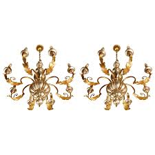 pair of vintage italian chandeliers p a pair of silver and gold painted wooden