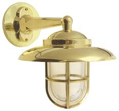 hooded wall light with cage solid brass interior exterior by shiplights beach