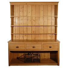 larger pine dresser with drawers and open shelves for