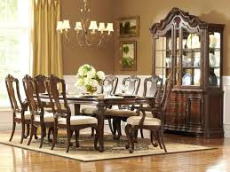 formal dining room furniture sets with round table made of wood and armchairs upholstered wooden base