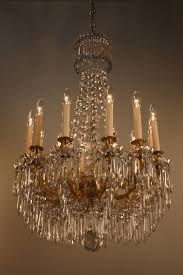 this stunning 19th century chandelier from france is made of beautiful bronze and crystal with