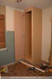diy bedside corner closet to maximize storage in a small bedroom