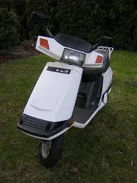 honda elite 80 motor scooter guide honda elite 80 white front view