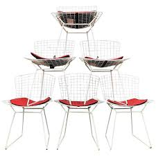 mid century knoll bertoia wire chairs in white with red seat pads for