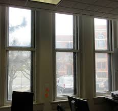 keeping an office space warm and toasty with discreet interior storm windows while maintaining the gorgeous plexiglass