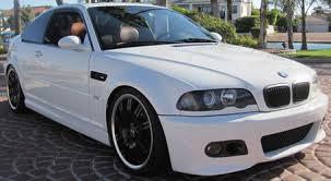bmw m3 2004 white. 2nd car 1999 hugger orange camaro ss bmw m3 2004 white