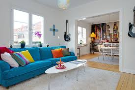 apartment design with contemporary look on the white wall versus striking turquoise sofa with colorful pillow