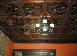 glue up antique copper ceiling tiles with overlapping edges or install in a grid suspended on