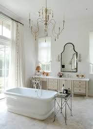french candle chandelier over center of the room tub