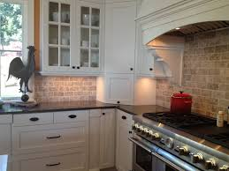Kitchen Backsplash White Cabinets Travertine With And Black Countertop Inside Design Decorating