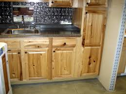 Metal Sink Cabinet Rustic Hickory Cabinets With Black Countertop And Chrome Metal
