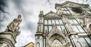 stendhal s syndrome the disease you can only catch in florence  xix century dante alighieri statue and santa croce cathedral in florence photo by