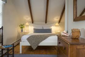 Furniture for a small bedroom Mini Small Attic Bedroom The Spruce Ways To Make Small Bedroom Look Bigger