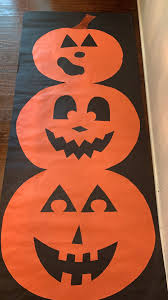 Homemade halloween decorations can be made out of essentially any material, and paper is a great material to start! Halloween Decor On A Budget Create Festive Door Or Wall Decor With Colored Bulletin Board Paper Perfect Spooky Decor Halloween Decorations Classroom Party