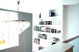 bookcases around fireplace flanking photos built in bookshelves beside