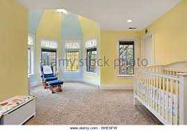 Baby's bedroom with yellow and blue walls - Stock Image