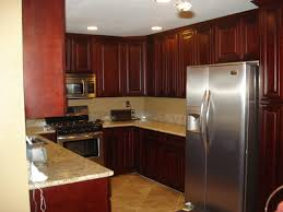 Red Floor Tiles Kitchen Red Wooden Kitchen Cabinet And White Ceiling Also Creamy Tile Of
