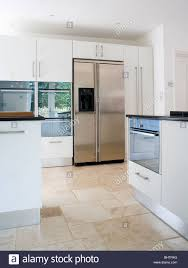 Limestone Flooring In Kitchen Limestone Flooring In Modern White Kitchen With Large Stainless