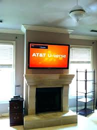 hanging tv over fireplace hanging flat screen tv over brick