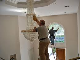 one other image of cleansing a chandelier