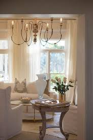 french living room with white sofa and gray pillows