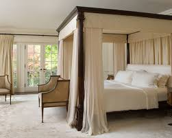 Traditional carpeted bedroom idea in Toronto with beige walls