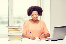 how to write a killer word essay example scholarshipowl happy african american young w sitting at table laptop computer and books at home