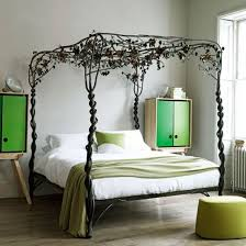 Fun teen bedroom decor with black iron bed frame and trendy side cupboards