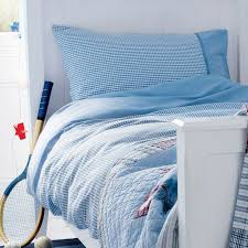 blue gingham cotton duvet set perfect for any boys room our versatile soft blue gingham cotton duvet set features contrast chambray trim is made from
