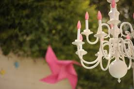 chandeliers are great light sources and can be used hanging from the trees from a gazebo or from an awning