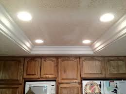 remove fluorescent lights replace with can lights and crown moulding