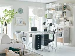Ikea office shelving Cabinet This Allwhite Home Office Stays Organized With Wall For Storage Using Ikea Ekby Ikea Workspace Inspiration Ikea