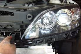 how to guide diy mazda angel eyes mazda forums the  on the bottom of the headlight assembly is a large plastic frame one phillips holds it on then there are pressure clips on either side