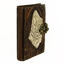 virgen engraved on metal refillable leather journal