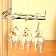hanging wine glass racks sliding wine glass onto homemade rack mounted under hanging kitchen cabinet ikea