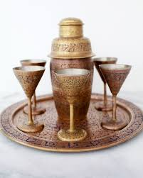 brass cocktail shaker and glasses from british india