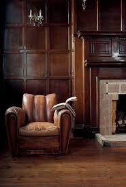 man cave want list beautifully worn leather club chair timber paneling classic fireplace perfect retreat