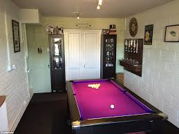 edward williams from the midlands has a purple pool table in his room as