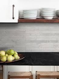 modern gray backsplash tile black countertop white cabinet