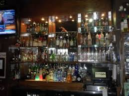 back bar 93w x 12d x 88h oak glass shelves custom fit to bar also includes bottle risers slatted oakwith interior lighting does not include contents back bar lighting