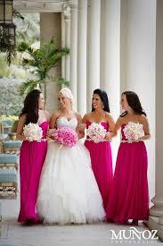 Fuchsia bridesmaid dresses and white bouquet